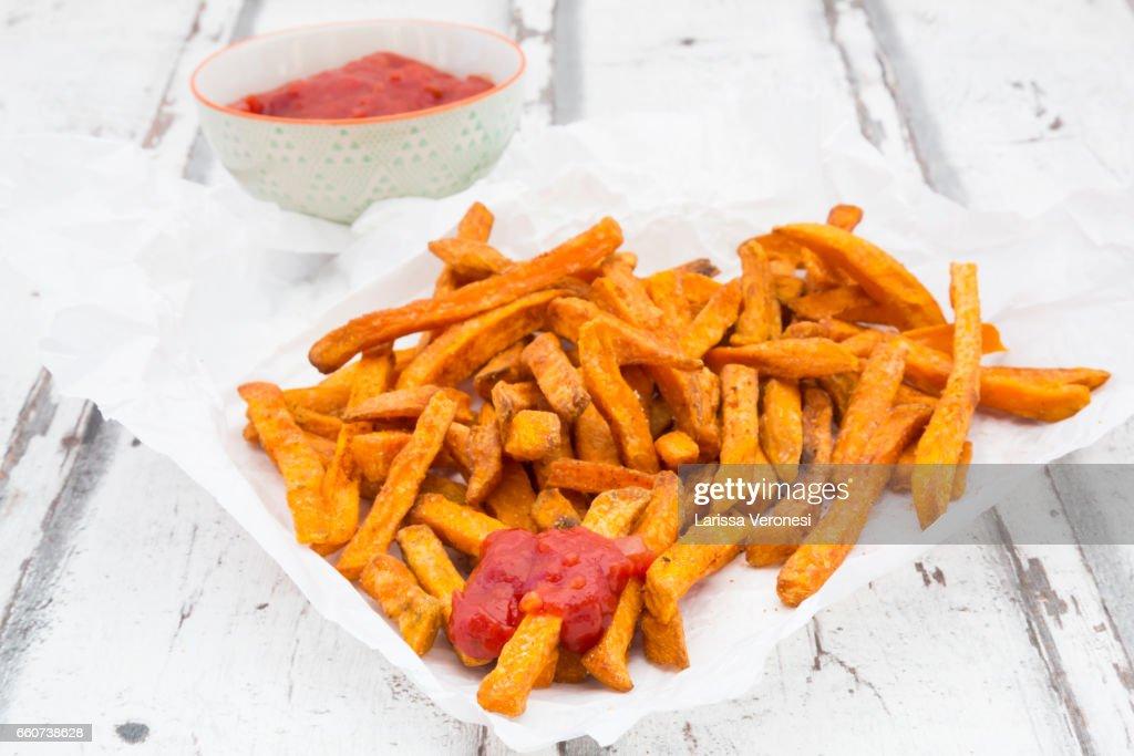 Sweet Potato French Fries with tomato sauce : Stock Photo