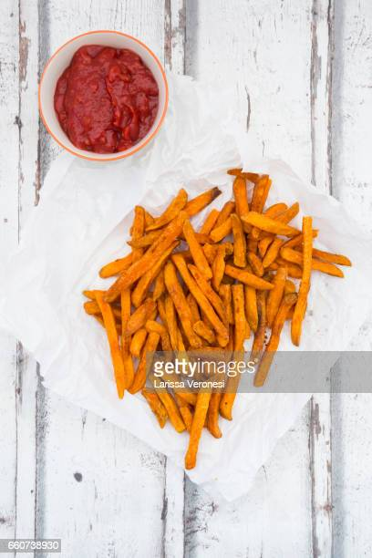 sweet potato french fries with tomato sauce - larissa veronesi stock pictures, royalty-free photos & images