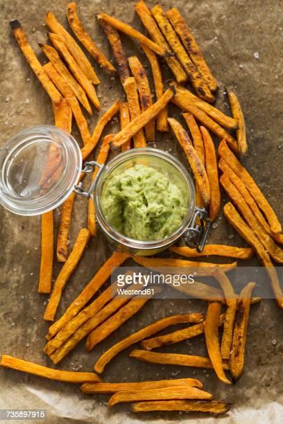 sweet potato fries and avocado dip - fries stock-fotos und bilder