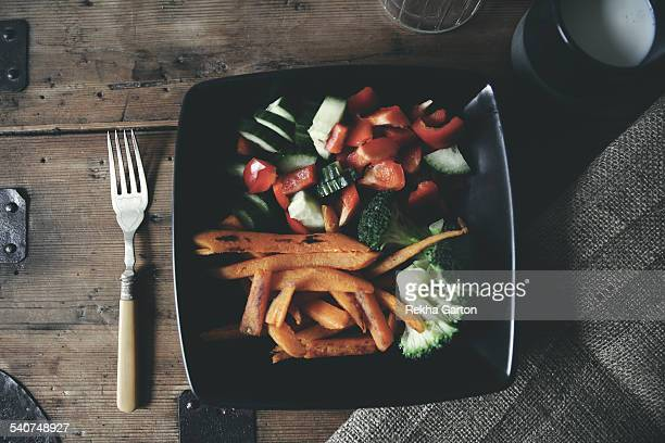 Sweet potato fries with salad