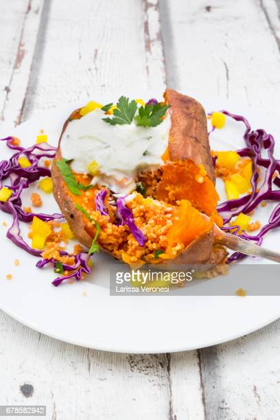 sweet potato kumpir - flat leaf parsley stock photos and pictures