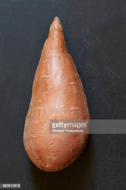 Sweet potato on black background