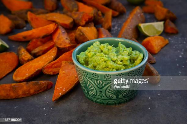 sweet potato wedges with avocado dip and fleur de sel - guacamole stock photos and pictures