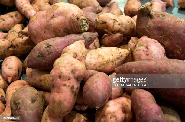 Sweet potatoes are pictured at the fruit and vegetable department of an 'O Marche' supermarket in SaintFrancois on the French overseas territory of...