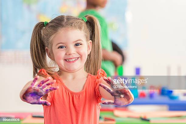sweet preschooler has fun with finger paints - finger painting stock pictures, royalty-free photos & images