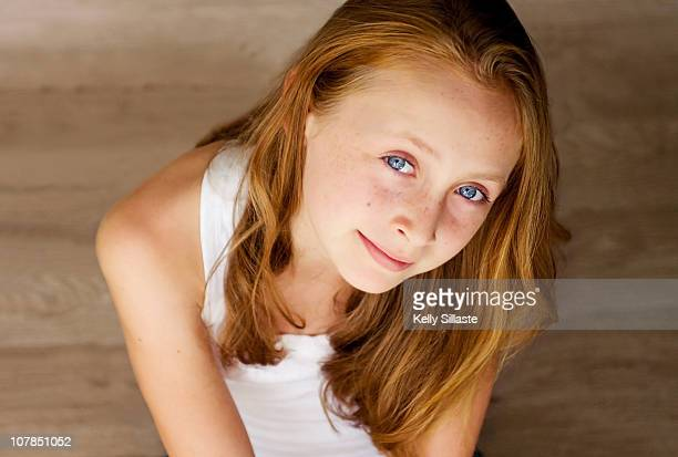 A sweet pre-teen girl with beautiful blue eyes