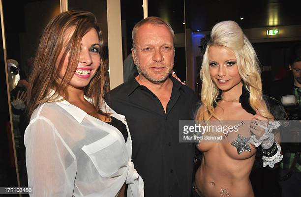 Sweet Selina Reinhard Nowak and Mia Julia Magma pose for a photograph during the Penthouse cover release party at Maxim Nightclub on June 27 2013 in...