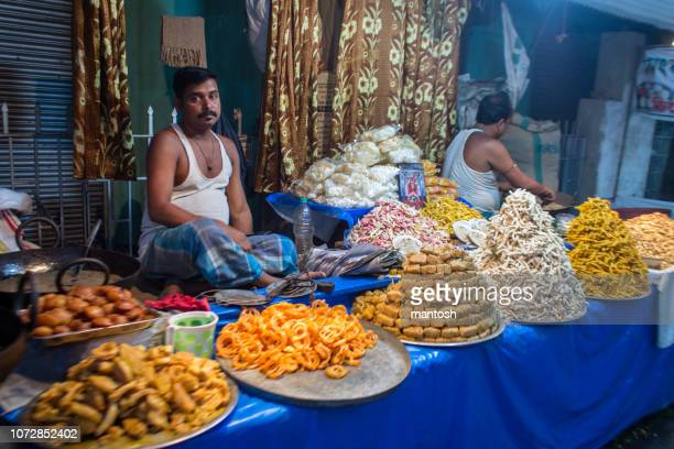 sweet shop in a festival market in india. - west bengal stock pictures, royalty-free photos & images