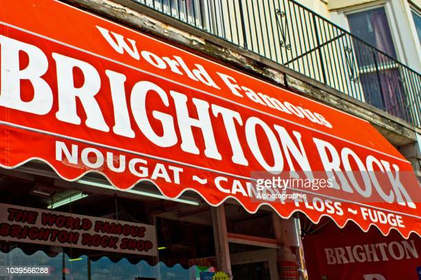 sweet shop selling the world famous brighton rock - image title stock pictures, royalty-free photos & images