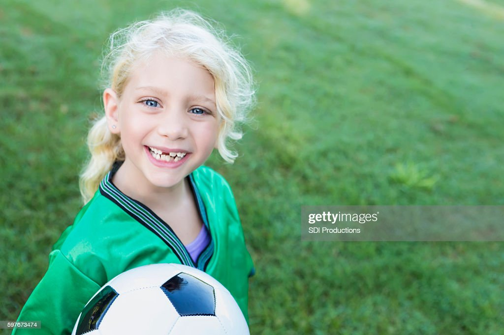 Sweet soccer girl with missing teeth : Stock Photo