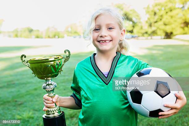 Sweet soccer player with championship trophy