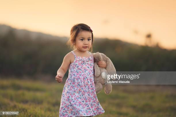 Sweet Toddler Girl Outdoors With Stuffed Bunny