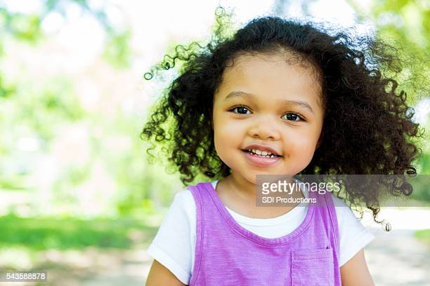 Sweet toddler in the park on a summer day