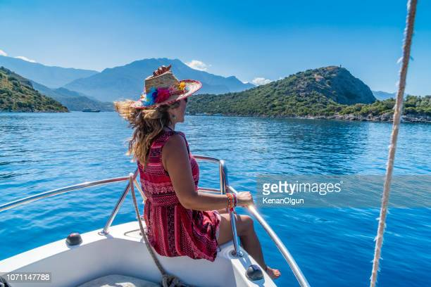 sweet woman sitting on boat. - aegean turkey stock pictures, royalty-free photos & images