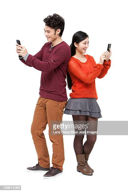 Sweet young couple with smart phone in Chinese New Year