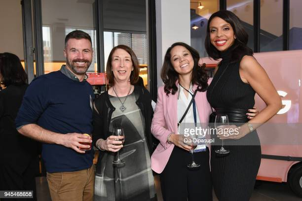 Sweeten cofounder and CEO Jean Brownhill poses with attendees during Vanity Fair's Founders Fair at Spring Studios on April 12 2018 in New York City