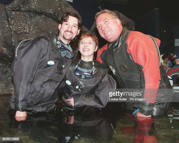 Sweethearts Robert Scotland 20 and his fiancee Morag Shaw with Reverand Richard Russell in the Safari Acquarium at 'DeepSea World' near Edinburgh...