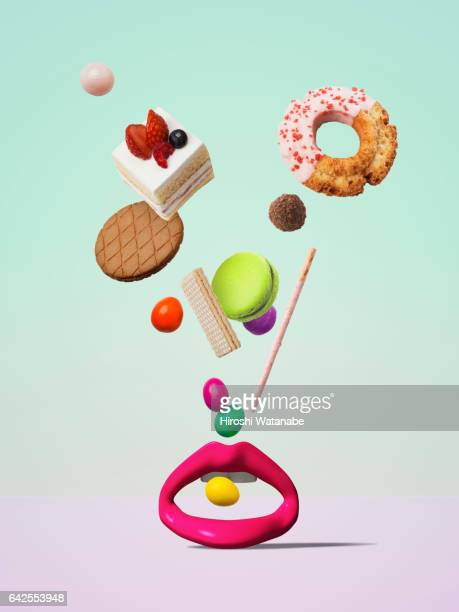 Sweets falling to the object of the mouth