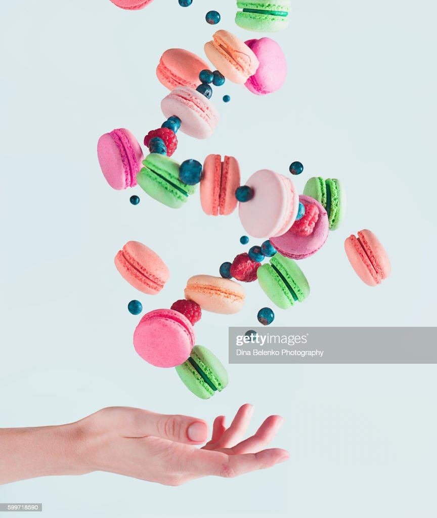 Sweets for a stage magician: flying macarons : Stock Photo