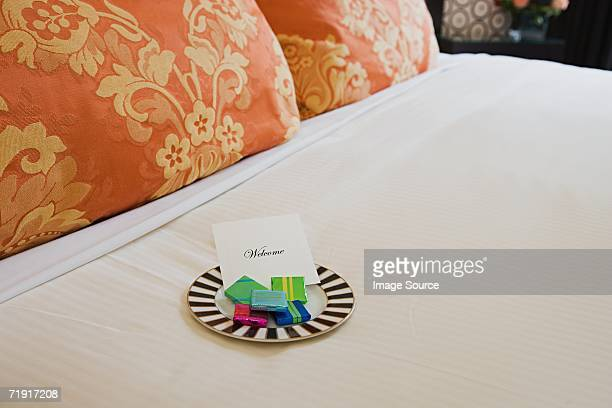 Sweets on a hotel bed