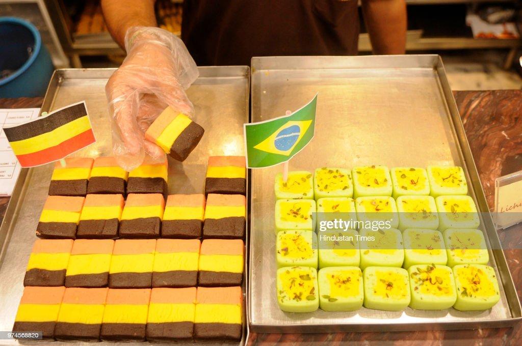 Sweets with German and Brazilian flag-coloured at Balaram Mullick & Radharaman Mullick Sweets Shop to celebrate FIFA World Cup Football Tournament at the shop at Bhowanipore, Jagu Bazar, on June 14, 2018 in Kolkata, India.