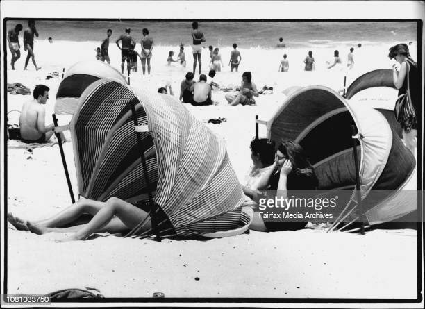 Melting on Bondi beach yesterday were sisters Simone 15 and Vanessa Dior and Michelle and Amanda Slade 15 December 08 1990