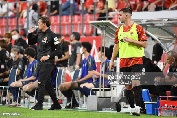 Swierczok of Nagoya Grampus stays the touch line after sustitution with Coach, Massimo Ficcadenti of Nagoya Grampus like Cristiano Ronaldo of...