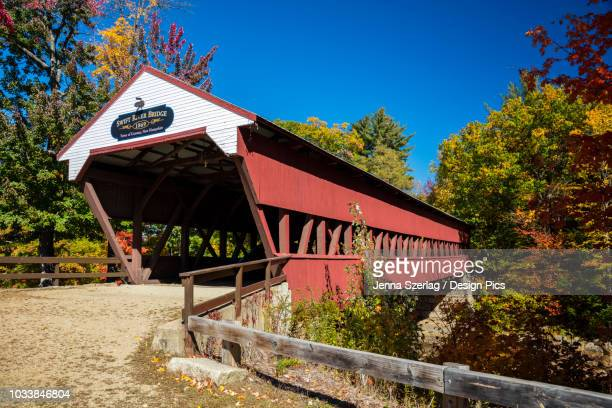 swift river covered bridge on a back country road in autumn, white mountains national forest - swift river stock pictures, royalty-free photos & images