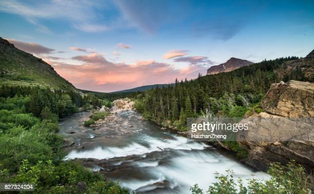 swiftcurrent falls - glacier national park, montana - rocky mountains north america stock pictures, royalty-free photos & images
