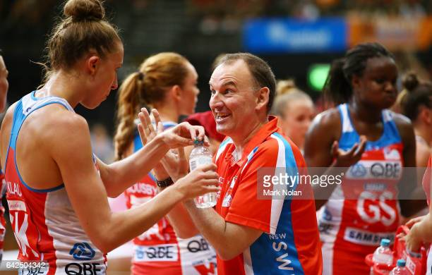 Swifts coach Rob Wright talks with his players during round one of the Super Netball between the Giants and Swifts at Sydney Olympic Park Sports...