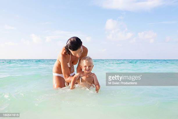 swim class mother and child - mexican and white baby stock photos and pictures