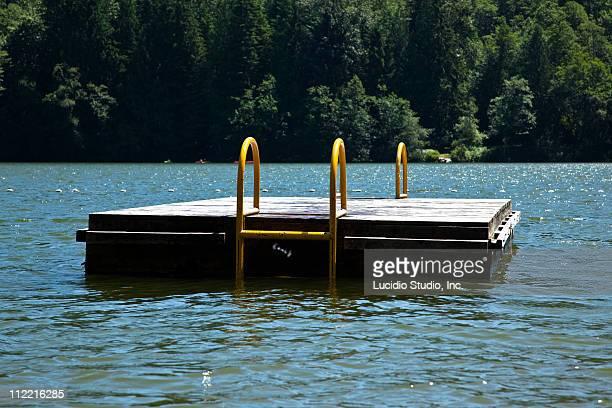 swim platform on a lake - diving platform stock pictures, royalty-free photos & images