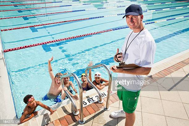 Swim team with coach
