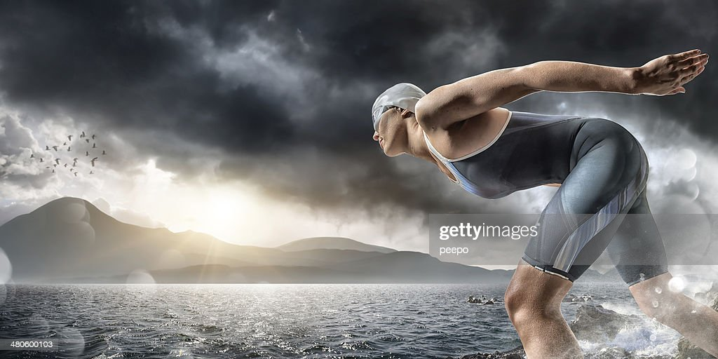Swimmer About To Dive In Sea : Stock Photo