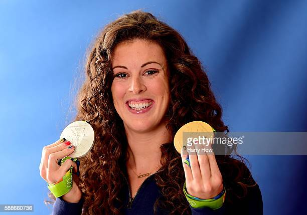 Swimmer Allison Schmitt of the United States poses for a photo with her silver and gold medals on the Today show set on Copacabana Beach on August 11...