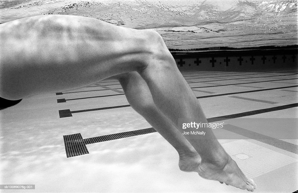 USA, Georgia, Atlanta, swimmer doing backstroke swim, low section, side view, underwater
