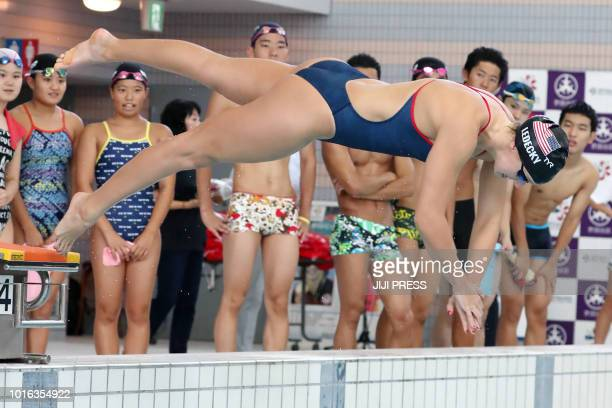 US swimmer and fivetime Olympic gold medallist Katie Ledecky holds a swimming class for local school students in Tokyo on August 14 as part of a...