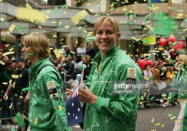 Swimmer and triple Gold Medalist Jodie Henry enjoys the National Welcome Home Parade for the Australian Olympic Team as they walk down George Street...