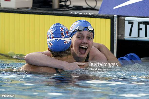 Swimmer Andrea Hupman congratulates winner and teammate Amanda Weir after finals of the 100 meter freestyle at the ConocoPhillips National...