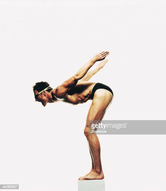 swimmer bending over to dive - young men in speedos stock pictures, royalty-free photos & images