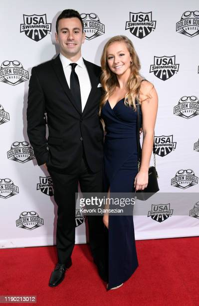 Swimmer Blake Pieroni and Ashley Hash pose during Golden Goggle Awards on November 24 2019 in Los Angeles California