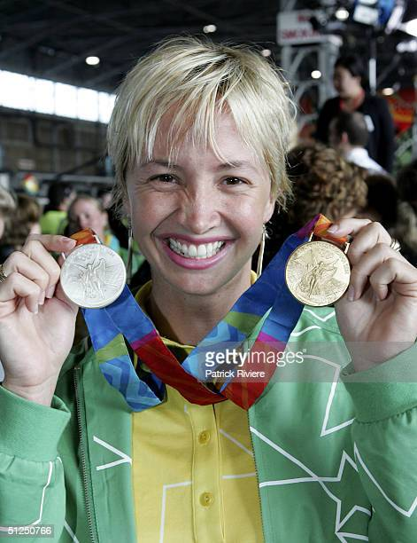 Swimmer Brooke Hanson poses with her medals during the Australian Olympic team homecoming welcome at the Qantas Jetbase September 1 2004 in Sydney...