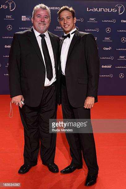 Swimmer Chad le Clos of South Africa and his father Bert le Clos attends the 2013 Laureus World Sports Awards at the Theatro Municipal Do Rio de...