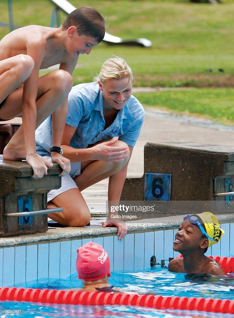 Swimmer Charlene Wittstock coaches children during a training session on December 2, 2006 in Richards Bay, South Africa.