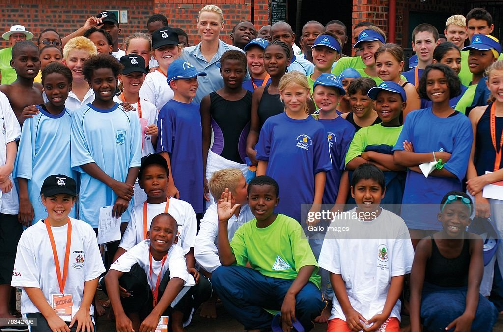 Swimmer Charlene Wittstock poses with participants of a childrens swim training she coached during a training session on December 2, 2006 in Richards Bay, South Africa.