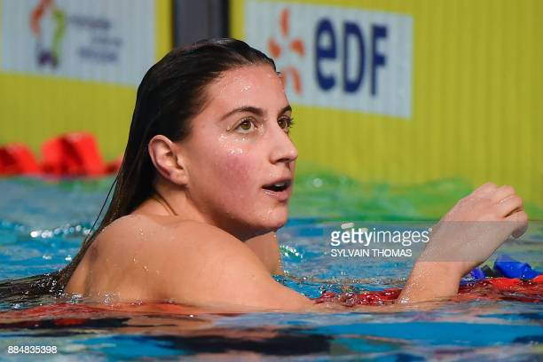 Swimmer Charlotte Bonnet reacts after winning the final of the women's 400meters freestyle at the 25m French swimming championships in Montpellier on...