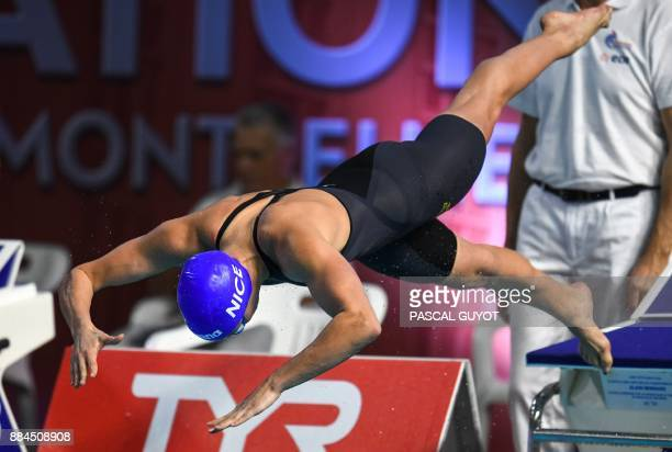 Swimmer Charlotte Bonnet takes the start of the final of the women's 50meters freestyle at the 25m French swimming championships in Montpellier on...