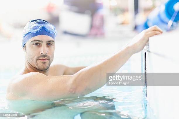 Swimmer climbing out of pool