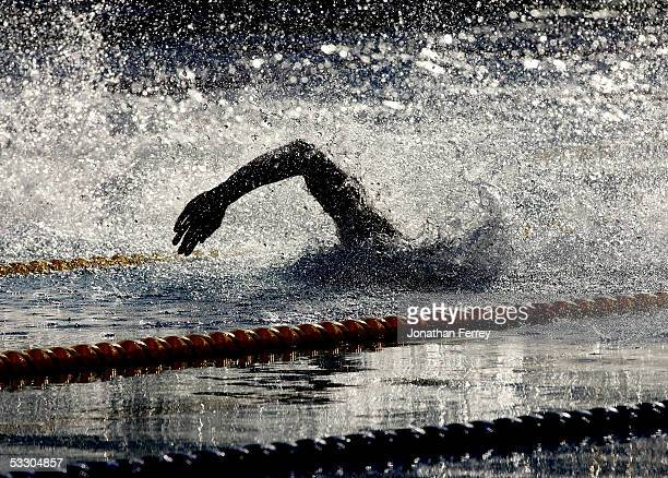 A swimmer competes in the semifinal of the 50 meter Freestyle during the XI FINA World Championships at the Parc JeanDrapeau on July 29 2005 in...
