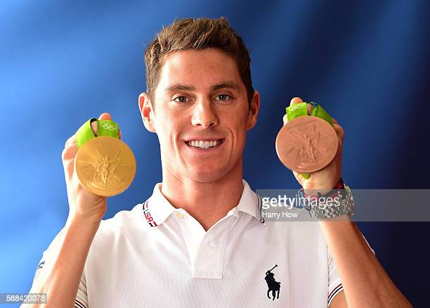 Swimmer Conor Dwyer of the United States poses for a photo with his bronze and gold medals on the Today show set on Copacabana Beach on August 10...
